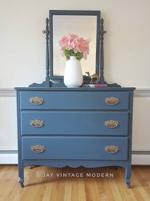 blue vanity with brass hardware