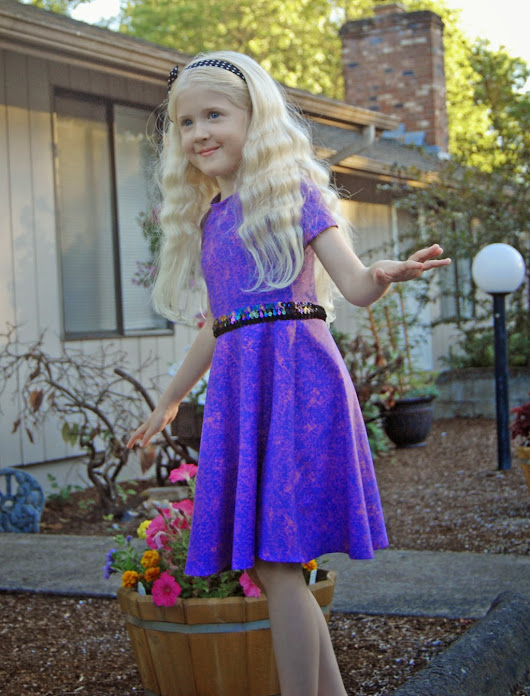 Summer knit dress, she loves dragons!