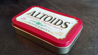 Photograph of an Altoids tin at an oblique angle