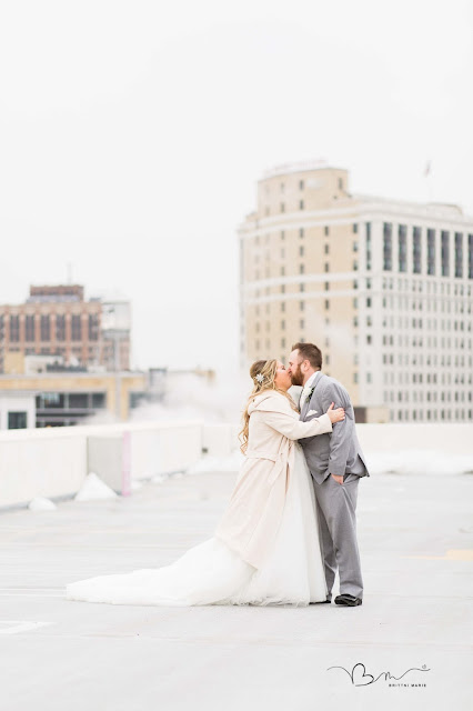 Photo of Bride and Groom kissing on Detroit Rooftop at Z Belt Lot