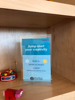 Jump-start your creativity acrylic sign in front of building toys on shelf