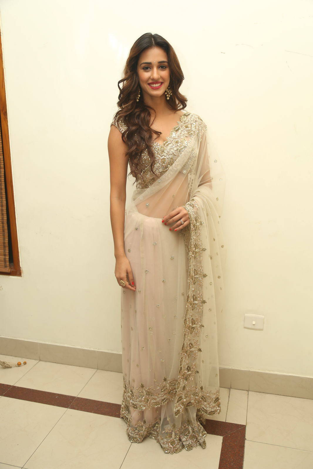 Disha Patani Stills In White Saree At Audio Launch