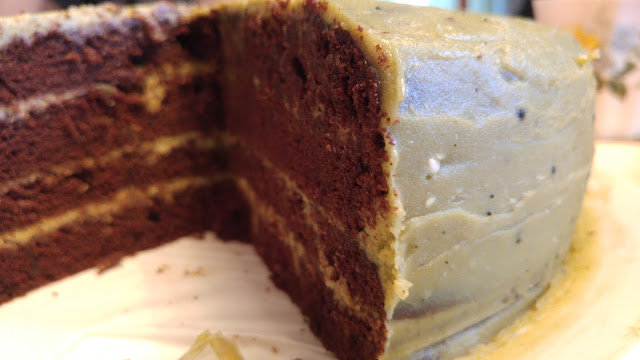 Inside a chocolate cake with matchabuttercream showing the layers of chocolate cake separated with buttercream