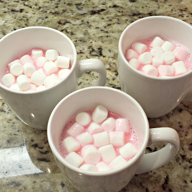 pink-hot-chocolate-in-a-white-mug-with-marshmallows-on-top