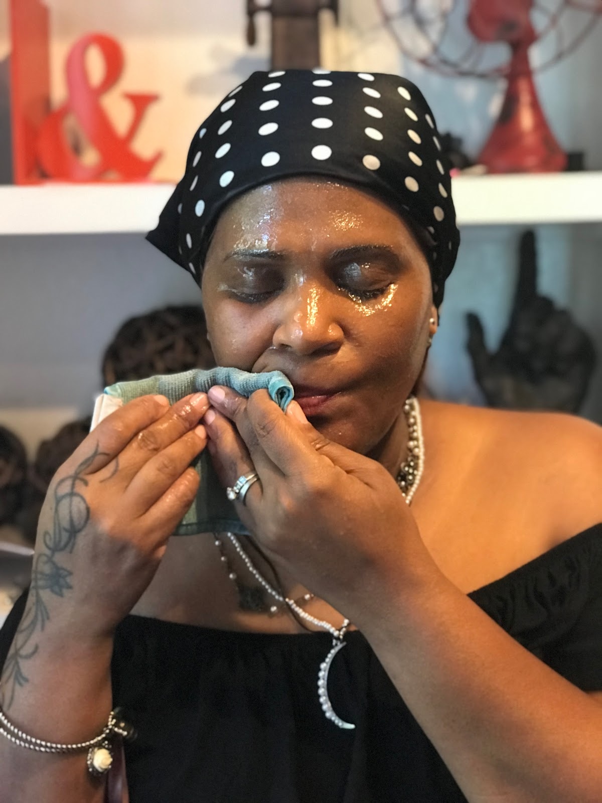 Image: Woman removing makeup without water off her mature skin. Nits and Babbles forty something babbling blog. This method works perfect on women of a certain age. Beauty and Skincare post. Personal regimen