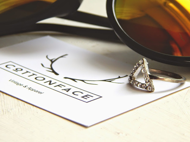 Close up of Cotton face logo and triangle ring