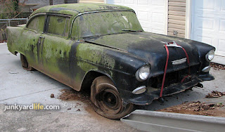 1955 Chevy looks dirty, moldy, and beautiful as she hits the ground.
