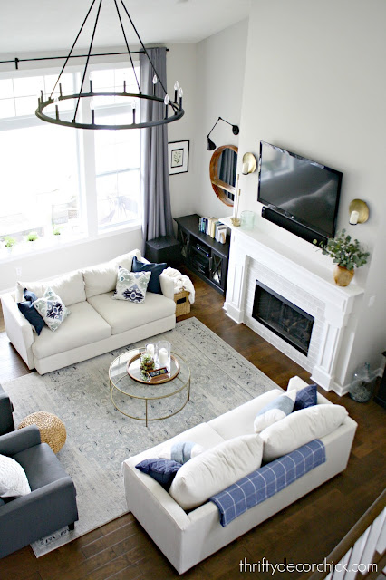 Symmetrical great room layout with two sofas