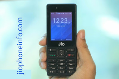 jio phone in right hand display time 12:23 am