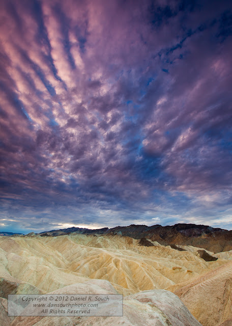a fine art photograph of zabriskie point at sunrise on a cloudy morning