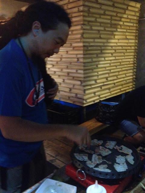 Ian cooking samgyeopsal at Azul Surf