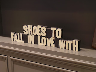 Sign saying shoes to fall in love with