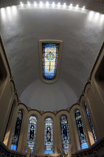 Image of ceiling over choir and apse showing stained glass windows of the apse and stained glass skylight