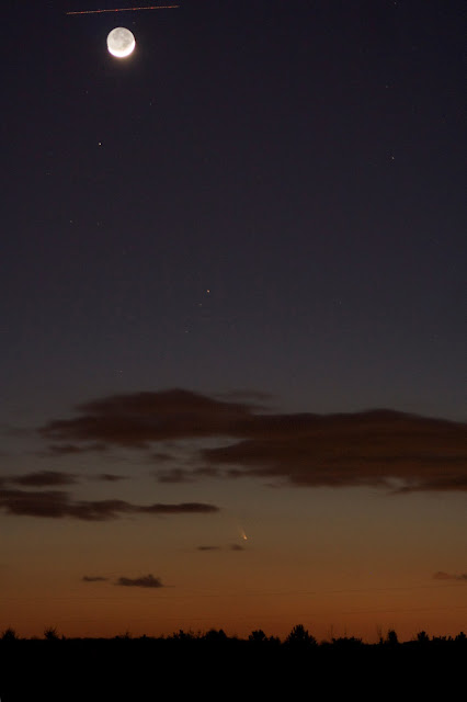 comet panstarrs with moon and plane