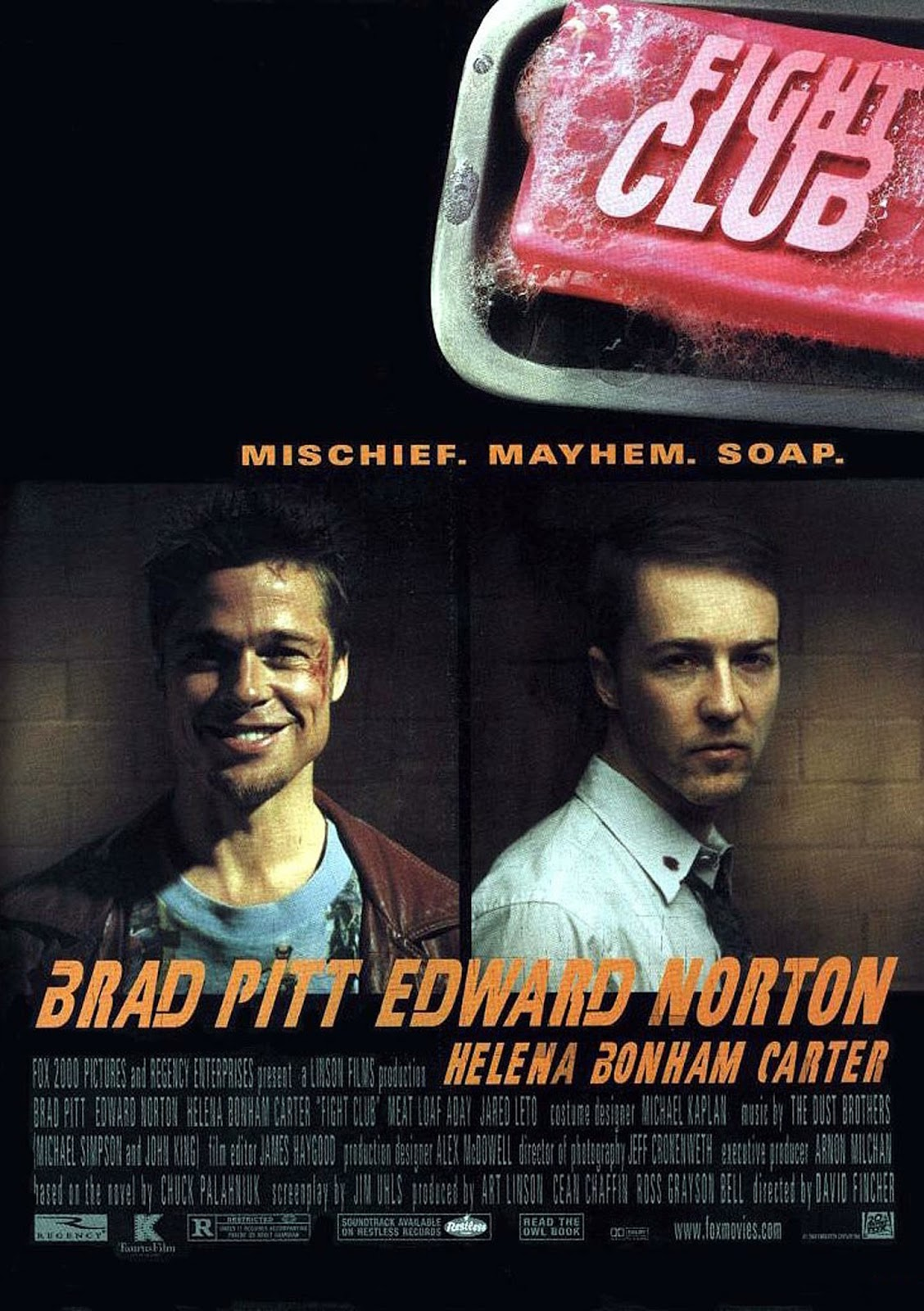 The theatrical release poster for Fight Club. From left to right it depicts a smiling Brad Pitt and a serious Edward Norton separated into two panels. The movie's tagline reads: Mischief. Mayhem. Soap. A photograph of a pink bar of soap is depicted in the top-right of the image with the title of the movie printed over top of it.