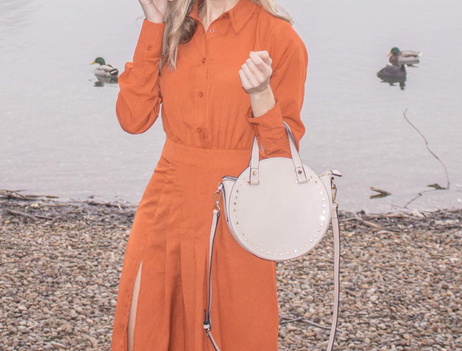 Rust Coloured Dress And Cream Bag