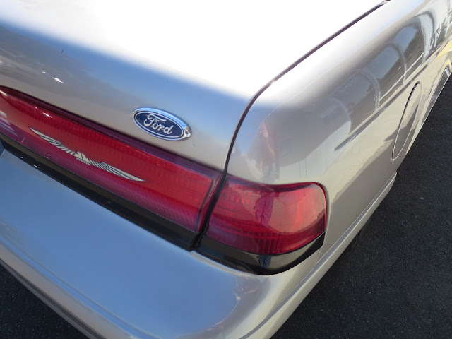 Dented quarter panel and misaligned trunk on Thunderbird after repairs at Almost Everything Auto Body