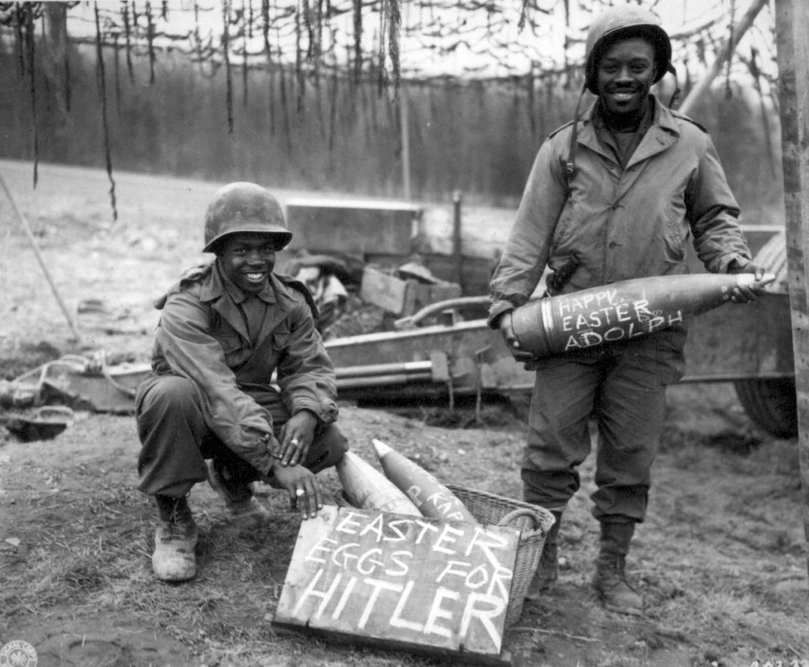 Two black American soldiers with special artillery ammo for Hitler. Photo was taken on March 10, 1945, during the Battle of Remagen.