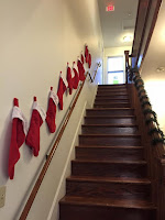 The stairs at international house decorated with Red Christmas Stockings