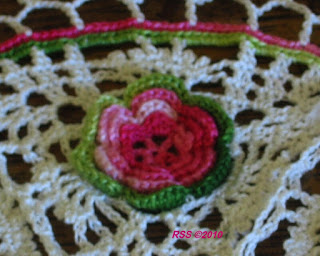 Closeup of Pink 3D Irish Rose in White Picot Lace Doily