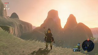 link with bright background and mountains legend of zelda breath of the wild screenshot
