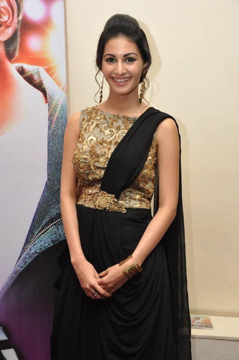 Telugu Girl Amyra Dastur Stills In Transparent Black Saree