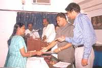 Distribution of participation certificate by Dr K M Prabhu and Mr Anand of Aravind Foundation