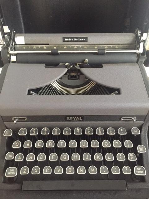 Black vintage Royal typewriter by Hello Lovely Studio