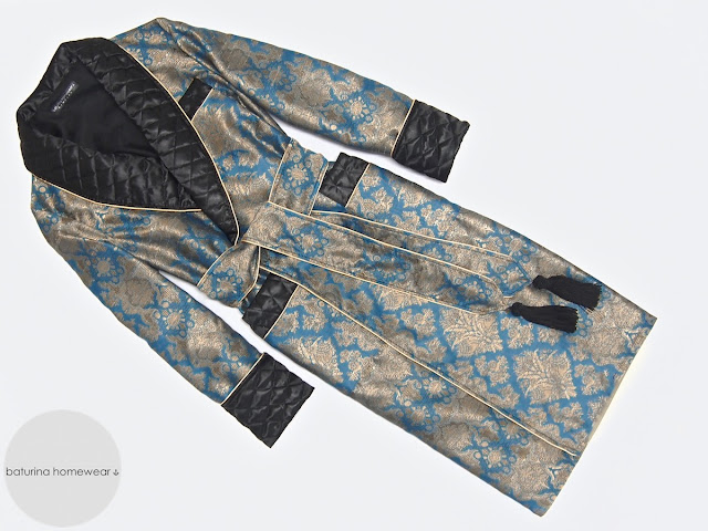 Men's dressing gown in full length with blue and gold paisley pattern and black quilted shawl collar