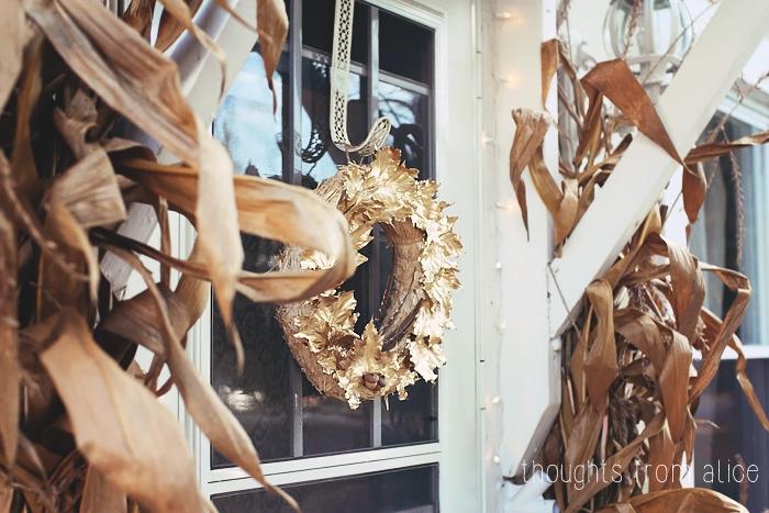 Golden wreath as a door accent