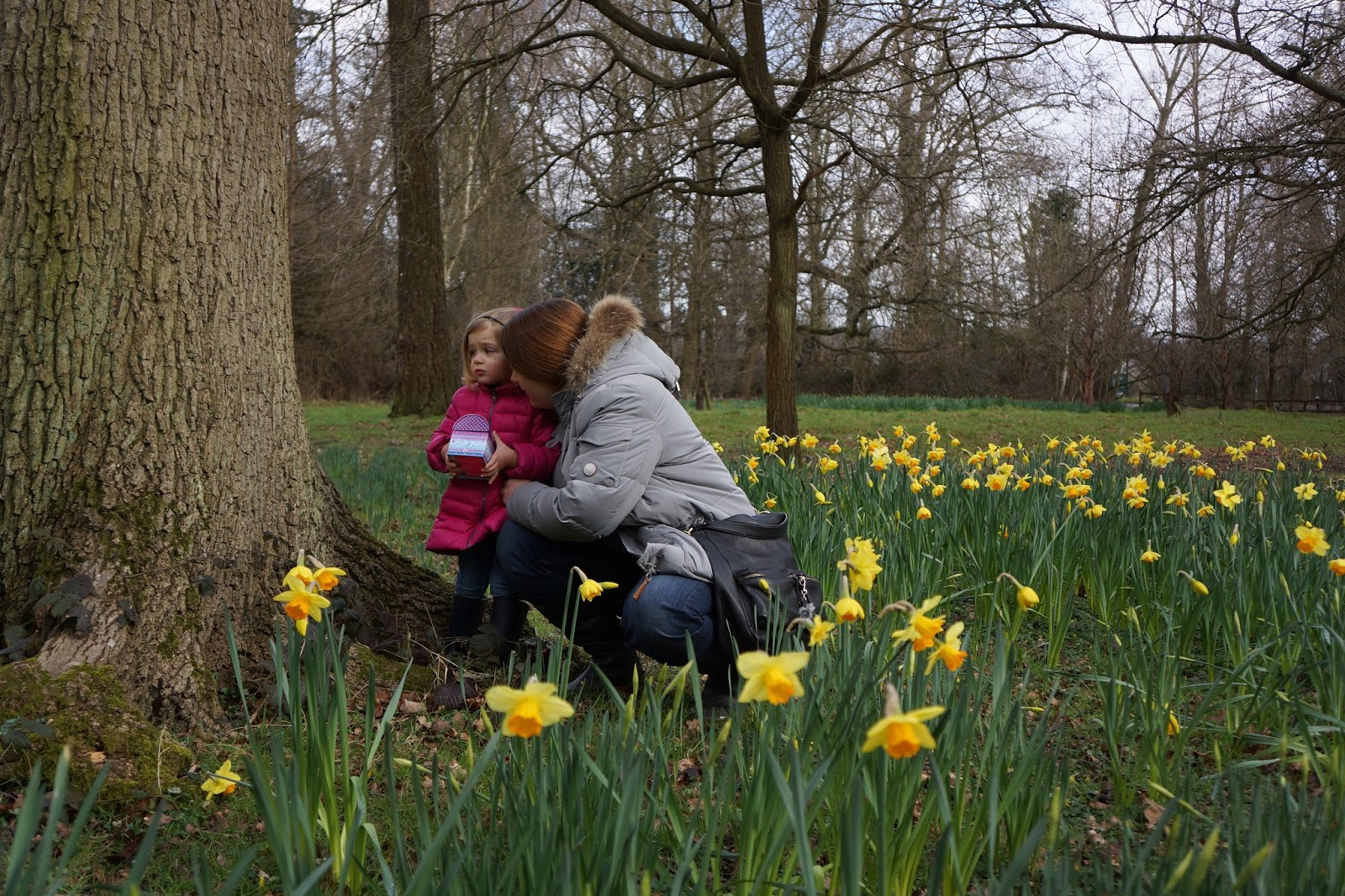 mother and daughter in a field of yellow flowers