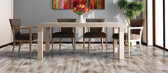Light hardwood floor enlarges this dining room