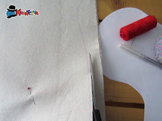 rifinire il taglio del pannolenci prima della cucitura