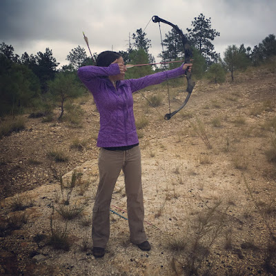 Sonja Stone shooting a Browning compound bow; bow and arrow in the desert