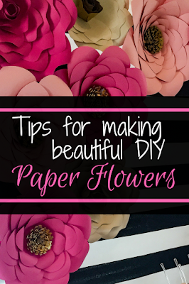 How to make a DIY Kate Spade inspired paper flower backdrop. Tips for making giant paper flowers. Pink, white and gold paper roses with black and white striped backdrop