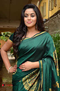 Actress Poorna Latest Pictures in Green Saree at SR Fashion Studio Launch  0005.jpg