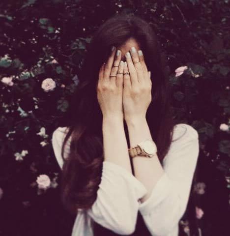 girl blush hiding face behind hands