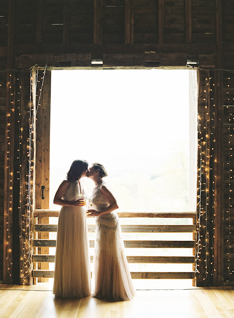The brides kiss in the the barn at Jonna and Heather's Inn at West Settlement Wedding by Karen Hill Photography