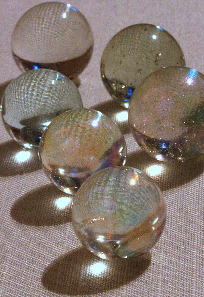 clear glass marbles, a color photograph close-up