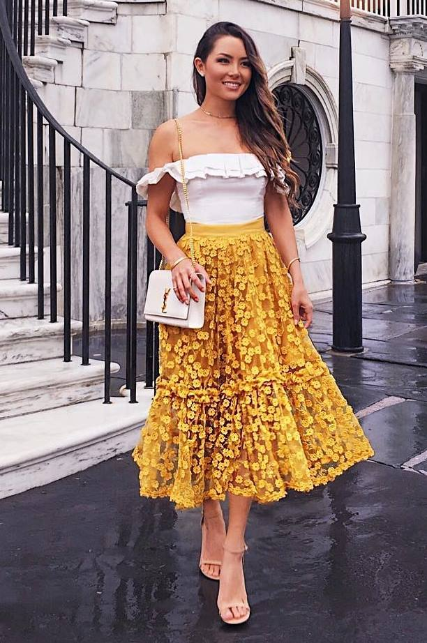 what to wear with a yellow midi skirt : heels + white bag + off shoulder top