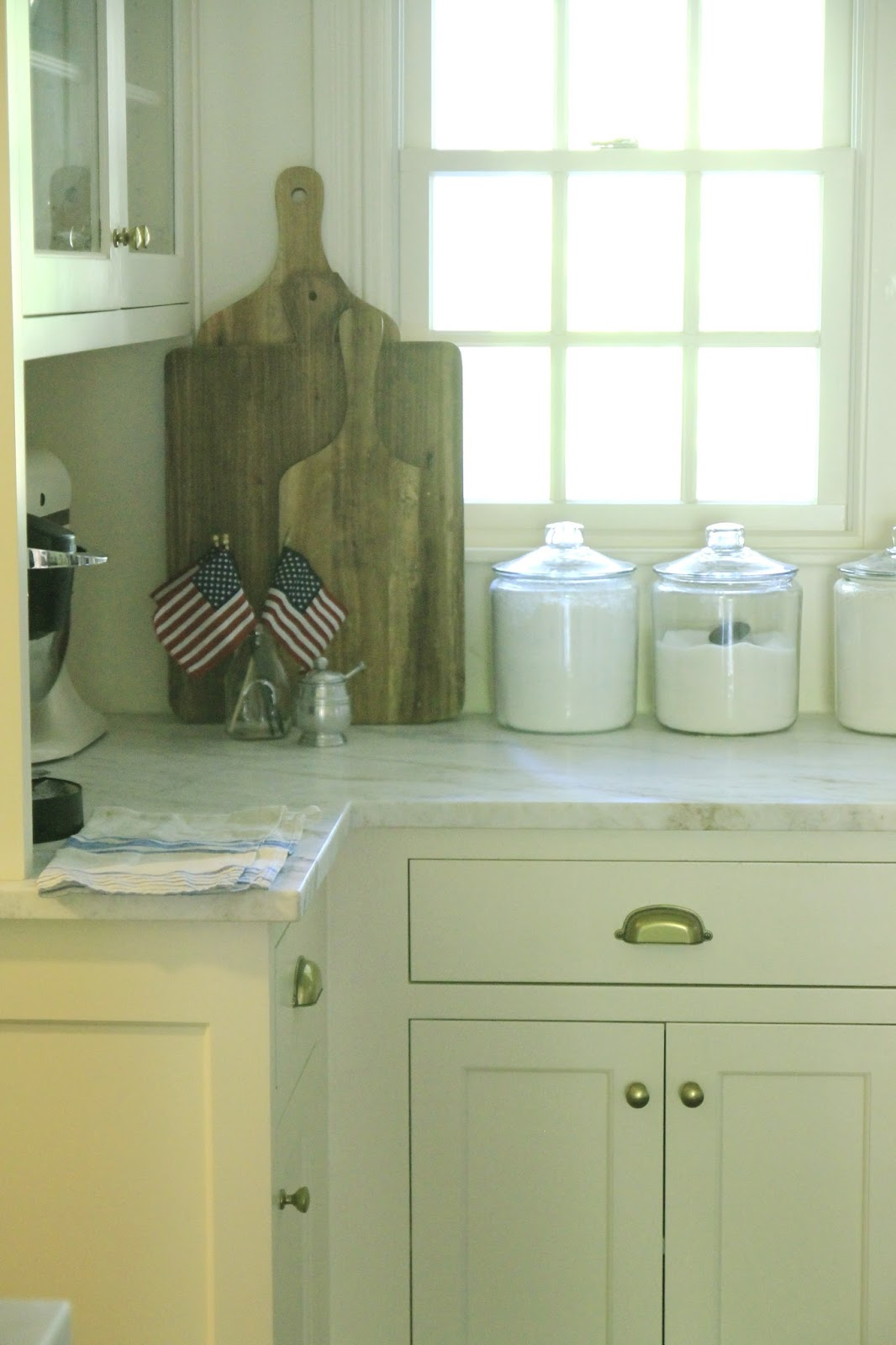 Patriotic kitchen - A Little Shatto Milk Bottle Filled With Small Flags Makes The Kitchen Feel Festive