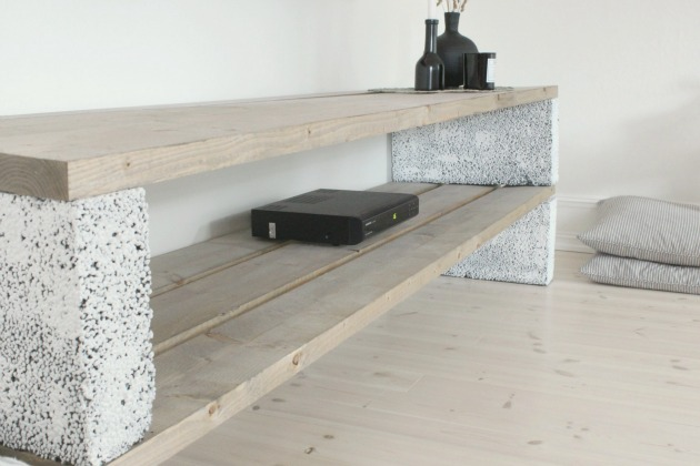 Cinder Blocks Shelf with Black Jars Pillows Wood Floors White Walls