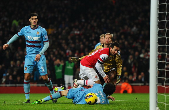 Santi Cazorla flicks the ball to score Arsenal's third goal against West Ham