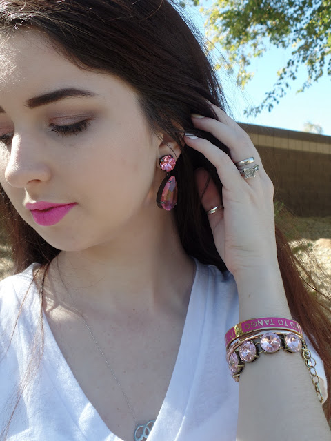 pink accessories with a white outfit