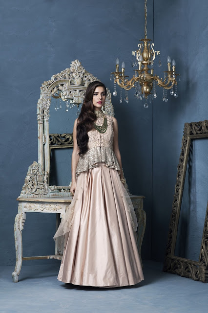 Peplum top in textured silk worn over plain duchess skirt by Designer Rashi Kapoor