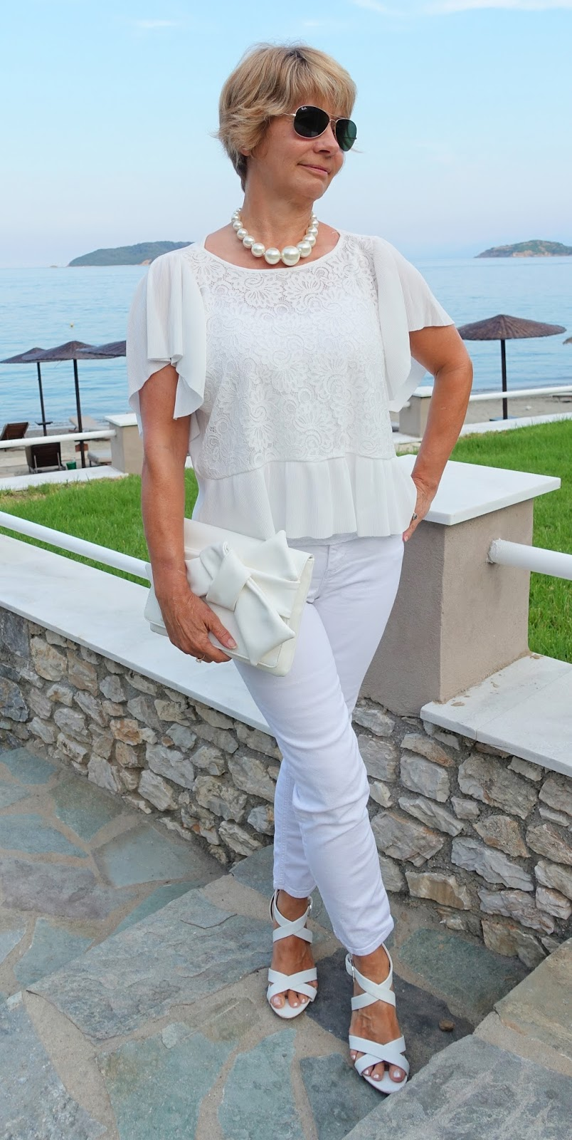 A monochromatic outfit - all white - for summer, shown by Is This Mutton's Gail Hanlon. Different textures from lace, pearls, leather and denim create interest.