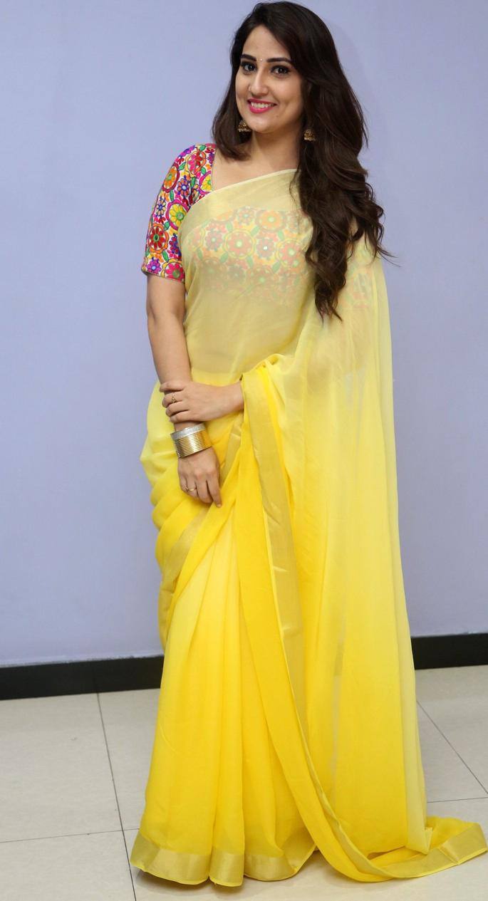 Glamours Telugu TV Anchor Manjusha Photos In Traditional Yellow Saree