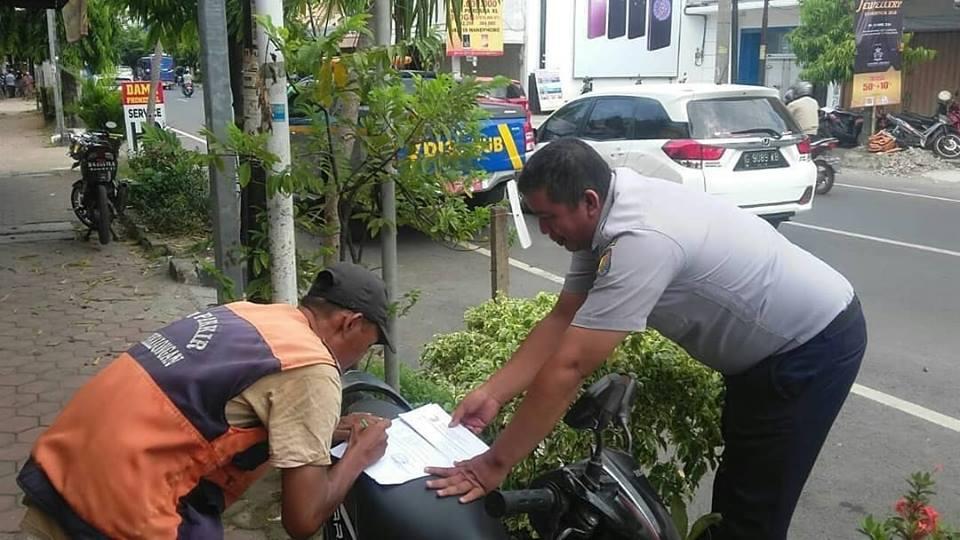 pembagian surat tugas juru parkir