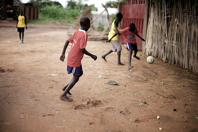 Boys playing soccer in Khartoum Sudan.