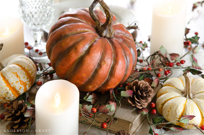 A mix of pumpkins, berries, and pinecones create a beautiful Thanksgiving centerpiece.  |  www.andersonandgrant.com